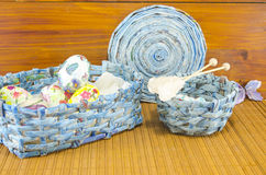 Blue basket full of handcolored Easter Eggs in decoupage Stock Photography