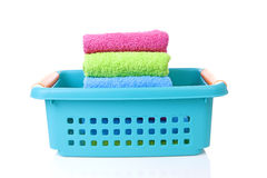 Blue basket made of plastic with laundry Royalty Free Stock Photography