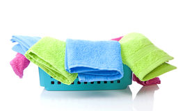 Blue basket made of plastic with laundry Royalty Free Stock Photo