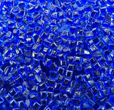 Blue batch of plastic polymer granules on white background Stock Photo