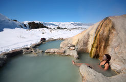 Blue Bath. A woman soaks in natural hot springs in California Royalty Free Stock Photo