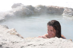 Blue Bath. A woman has a relaxing soak in a natural hot spring in central california Stock Photos