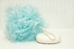 Blue bath puff and soap Royalty Free Stock Photo