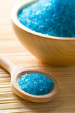 Blue bath salt. In wooden scoop Royalty Free Stock Photo