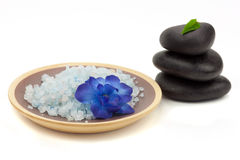 Blue bath salt with black spa stones Royalty Free Stock Photo