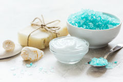 Blue Bath Salt, Body Cream And Shells For Spa On White Table Background Royalty Free Stock Photography