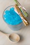 Blue Bath Salt in Glass Royalty Free Stock Image