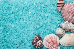 Blue bath salt and seashells Royalty Free Stock Images