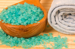Blue bath salt in spoon. And rolled towel Stock Image