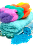 Blue bath salt with towels, mops isolated on white Royalty Free Stock Image