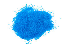 Blue bath salt on white. Picture of aromatic blue bath salt on white background Royalty Free Stock Photography