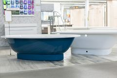 Blue bath in the store. hite bath in the building store. baths in the plumbing store. Sanitary engineering shop. White bathrooms. Shop baths. Plumbing. new royalty free stock photography