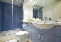 Blue bathroom. Modern blue bathroom with shower cabin Royalty Free Stock Photography