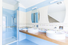 Blue bathroom with double sinks Stock Photography
