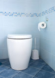 Blue bathroom. Modern white toilet bowl in blue bathroom Royalty Free Stock Image