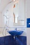 Blue  bathroom is in a new house Stock Photos
