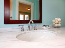 Blue bathroom with white marble sink. Royalty Free Stock Image