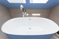 Blue bathtub in bathroom Stock Photos