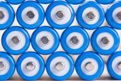 Blue batteries background Stock Image