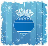 Blue bauble and bow with ribbon over planks Royalty Free Stock Images