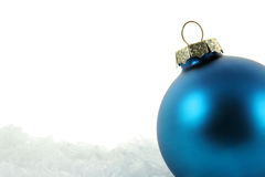 Blue Bauble in the Snow Upclose Royalty Free Stock Image