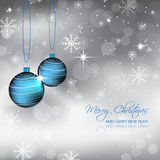 Blue bauble and snowflakes on a christmas winter background Royalty Free Stock Image