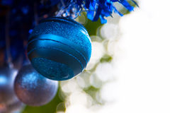 Blue baubles and bokeh Royalty Free Stock Photos