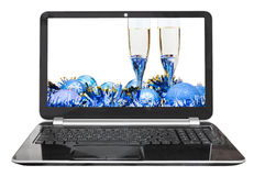 Blue baubles and glasses on laptop Royalty Free Stock Images