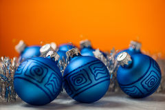 Blue baubles with shiny tape in background Stock Photography