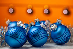 Blue baubles with shiny tape in background Royalty Free Stock Photography