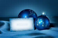 Blue baubles on a silk with postcard Royalty Free Stock Image