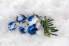 Blue baubles in snow Royalty Free Stock Photography