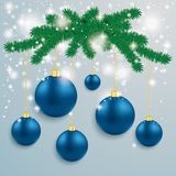 Blue Baubles Snow Lights Fir Branch. Snow with blue baubles and fir branches on the grey background Stock Image