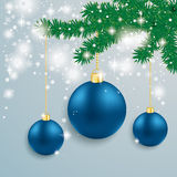 Blue Baubles Snow Lights Red Ribbon Fir Branch. Snow with blue baubles and fir branches on the grey background Royalty Free Stock Photography