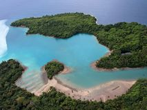 Papua New Guinea Bay. A blue bay at a sandy coast of Papua new Guinea stock image