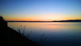 Blue Bay Sunset. This picture was taken in Blue Bay, on Flathead lake in Montana. The natural colors here are incredible, and light up the surface of the lake Stock Images