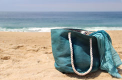 Blue beach bag on the seacoast and shawl Royalty Free Stock Images