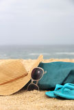 Blue beach bag on the seacoast and straw hat Royalty Free Stock Photos