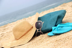 Blue beach bag on the seacoast and straw hat Stock Photography