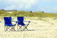 Blue beach chairs Stock Images