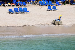 Blue Beach chairs. Vacationers soak in the sun and tropical beach on the island of Palomino in Puerto Rico Royalty Free Stock Images