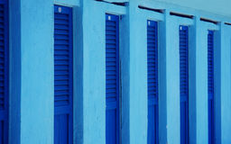 Blue beach changing rooms Stock Images