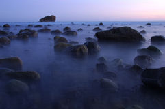 Blue beach at dusk. Beautiful shot of Malibu, Leo Carrillo Beach, at lowtide after sunset Stock Photography