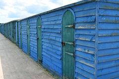 Blue beach hut with green doors Stock Image