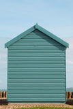 A blue beach hut on a sunny day.  Stock Photo