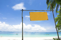 Blue beach with signboard Stock Photo