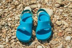 Blue beach slippers Stock Photos