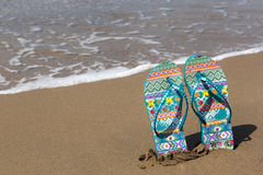 Blue beach slippers on sandy beach with copy space Stock Photography