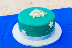A blue beach themed wedding cake decorated starfish. Royalty Free Stock Image
