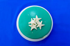 A blue beach themed wedding cake decorated starfish. Royalty Free Stock Photos